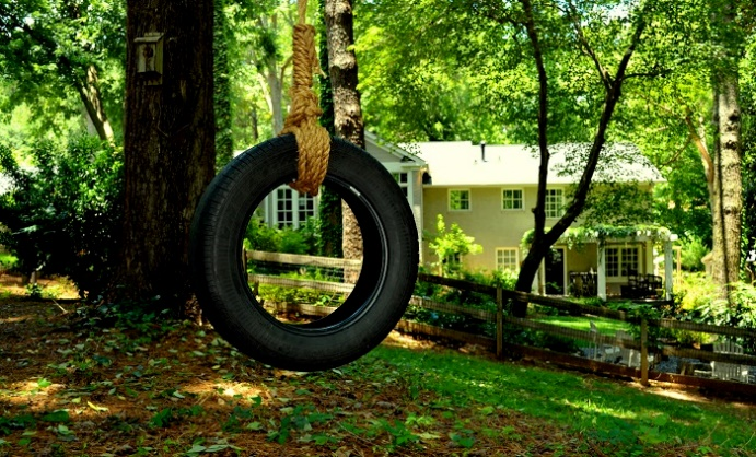 Image result for images of a swing made from tyre and rope